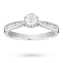 EXCLUSIVE - 0.33 carat total weight brilliant cut solitaire and diamond set shoulders ring in 18 carat white gold
