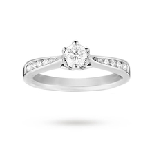 EXCLUSIVE - 0.50 carat total weight brilliant cut solitaire and diamond set shoulders ring in 18 carat white gold