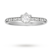 Brilliant cut 0.45 total carat weight diamond solitaire and diamond set shoulders ring in 18 carat white gold