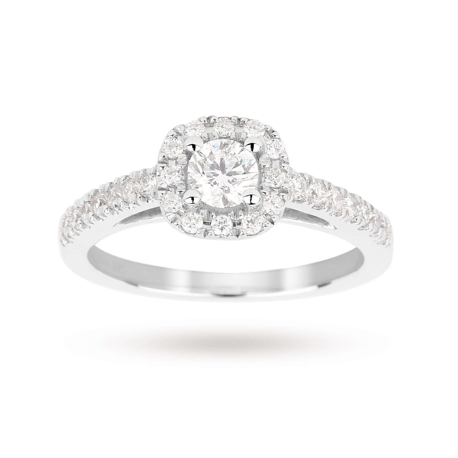 Brilliant cut 0.65 total carat weight diamond halo ring with diamond set shoulders in 18 carat white
