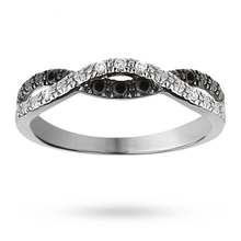 Brilliant cut 0.10 total carat weight diamond cross over ring set in 9 carat white gold
