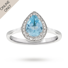 1.00 carat pear cut blue topaz and 0.10 carat total weight diamond ring in 9 carat white gold